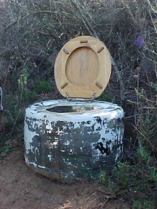Tom's toilet uses a big truck tyre and a regular toilet seat. You can line this with big plastic bags or or use it over a water-safe trench.