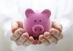Man holding piggy bank. Shallow DOF
