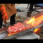 Grilling steaks over lava. Because we can.