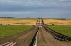 Photo: Tony Webster, Flickr, CC BY-SA 2.0. The DAPL (Dakota Access Pipeline) being installed between farms, as seen from 50th Avenue in New Salem, North Dakota.