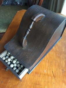 Image: Wooden throw thingy with balls and squares - Kelly McCarthy